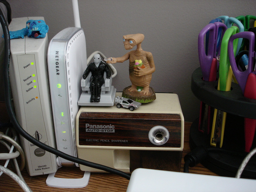 ET on a pencil sharpener, desk view