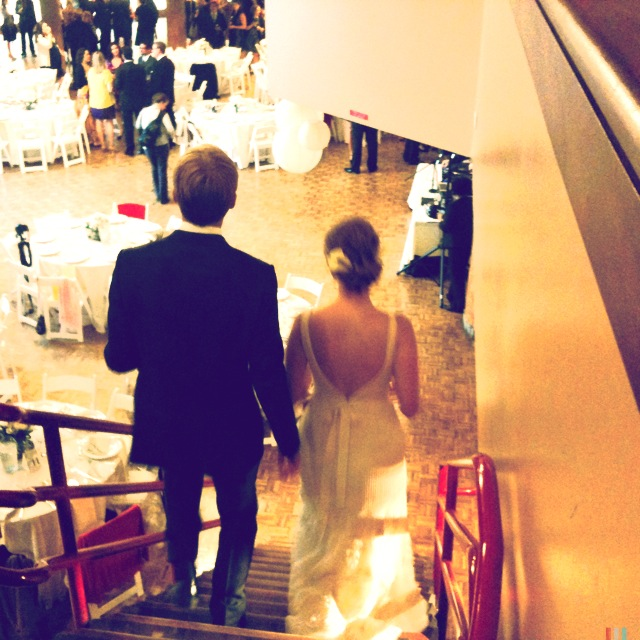 walking down the stairs to their wedding